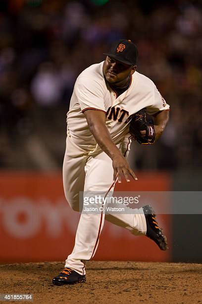 Jean Machi of the San Francisco Giants pitches against the Cincinnati Reds during the seventh inning at ATT Park on June 26 2014 in San Francisco...