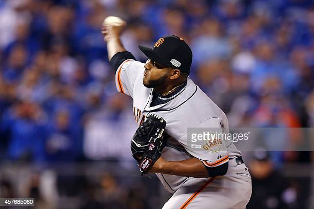 Jean Machi of the San Francisco Giants pitches against the Kansas City Royals during Game Two of the 2014 World Series at Kauffman Stadium on October...