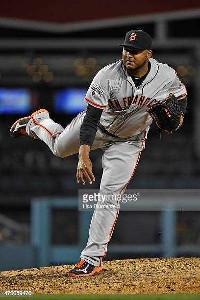 Jean Machi of the San Francisco Giants pitches against the Los Angeles Dodgers at Dodger Stadium on April 29 2015 in Los Angeles California