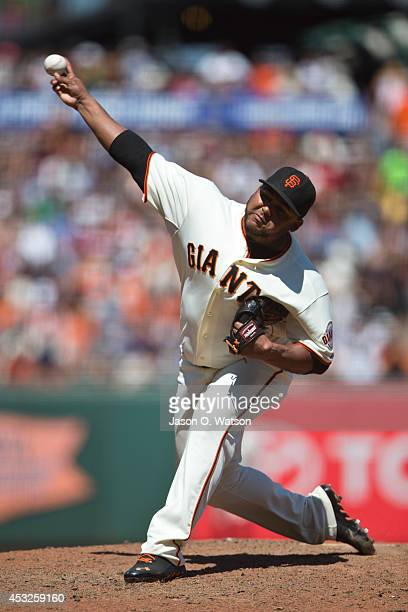 Jean Machi of the San Francisco Giants pitches against the Pittsburgh Pirates during the seventh inning at ATT Park on July 30 2014 in San Francisco...