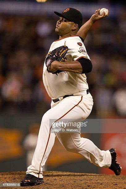 Jean Machi of the San Francisco Giants pitches against the San Diego Padres during the ninth inning at ATT Park on June 24 2015 in San Francisco...