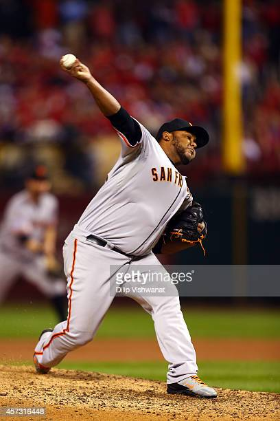 Jean Machi of the San Francisco Giants pitches against the St Louis Cardinals during Game Two of the National League Championship Series at Busch...