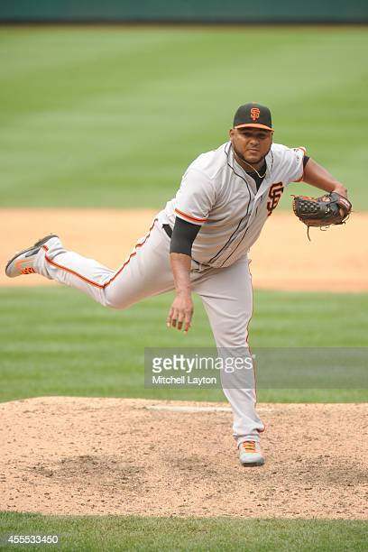 Jean Machi of the San Francisco Giants pitches during a baseball game against the Washington Nationals on August 24 2014 at Nationals Park in...