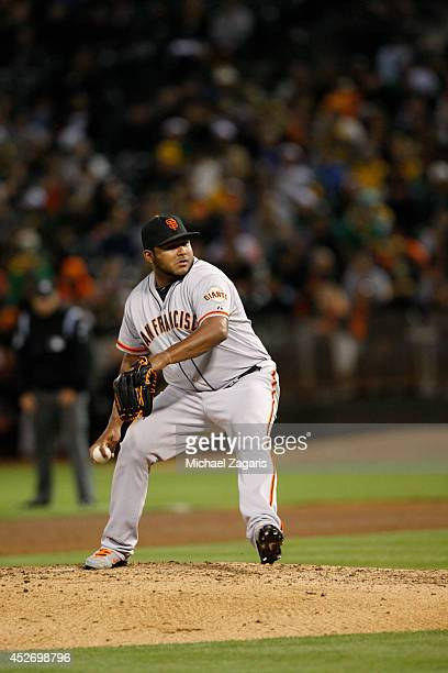 Jean Machi of the San Francisco Giants pitches during the game against the Oakland Athletics at Oco Coliseum on July 8 2014 in Oakland California The...