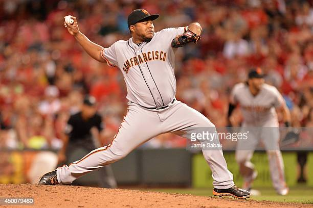 Jean Machi of the San Francisco Giants pitches in the eighth inning against the Cincinnati Reds at Great American Ball Park on June 4 2014 in...
