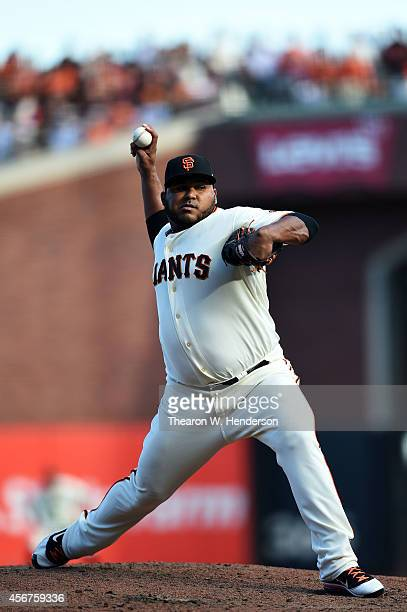 Jean Machi of the San Francisco Giants pitches in the eighth inning against the Washington Nationals during Game Three of the National League...