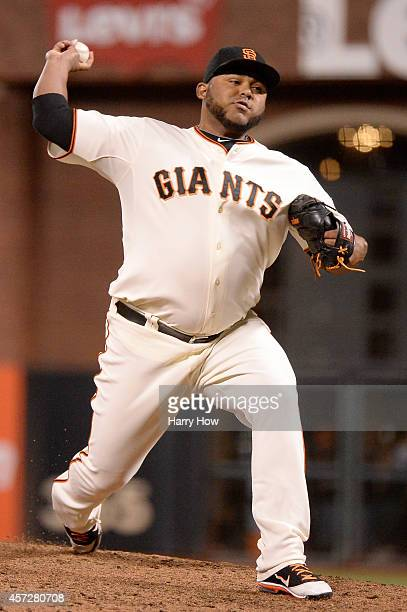 Jean Machi of the San Francisco Giants pitches in the seventh inning against the St Louis Cardinals during Game Four of the National League...