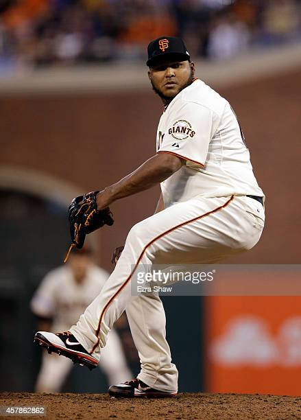 Jean Machi of the San Francisco Giants pitches in the third inning against the Kansas City Royals during Game Four of the 2014 World Series at ATT...
