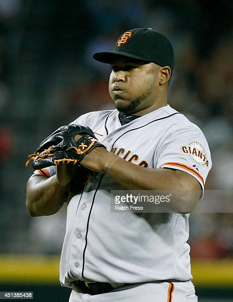 Jean Machi of the San Francisco Giants prepares to throw a pitch against the Arizona Diamondbacks during a MLB game at Chase Field on June 21 2014 in...