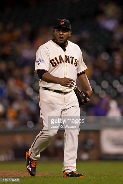 Jean Machi of the San Francisco Giants returns to the dugout after being relieved against the Los Angeles Dodgers during the ninth inning at ATT Park...