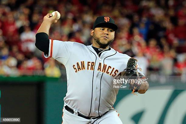 Jean Machi of the San Francisco Giants throws a pitch in the eighth inning against the Washington Nationals during Game Two of the National League...