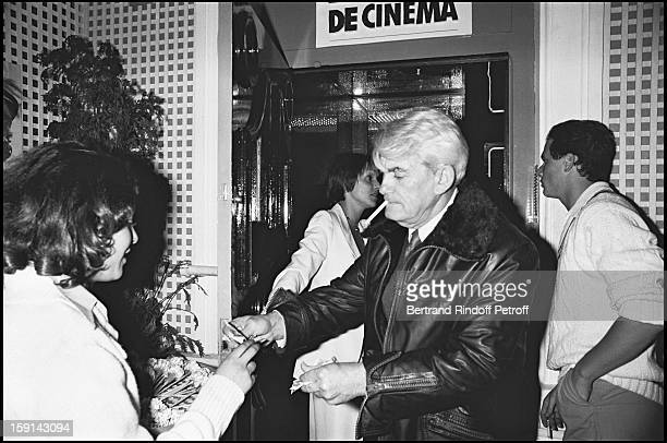 Jean Marais signs an autograph during a party to celebrate JeanPaul Belmondo's 20 years of movie career