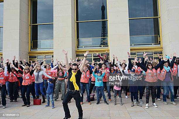 Jean Marc Genereux leads the flash mob during the 24th Rallye Aicha Des Gazelles 2014' Departure At Bassin du Trocadero on March 15 2014 in Paris...