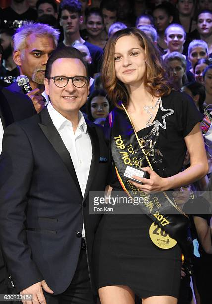 Jean Marc Genereux Sattya Oblette and a 2017 awarded model attend the 'Top Model Belgium 2017' Ceremony at Le Lido on December 18 2016 in Paris France