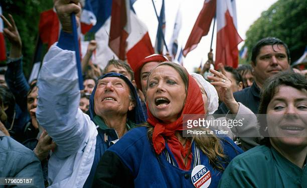Jean Marie Le Pen Bruno Megret Jean Marie Stirbois at a demonstration Le Pen and National Front before the statue of Jeanne d'Arc in Paris Jean Marie...