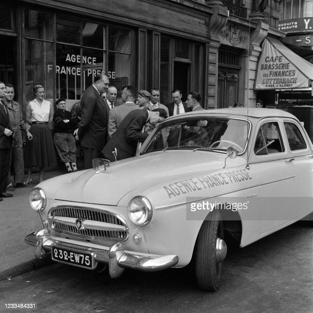 Jean Marin , managing director of the French press agency Agence France Presse , talks with journalists setting off for a report, on July 12 outside...