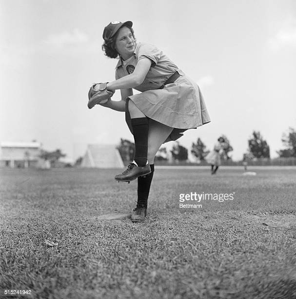 Jean Marlowe of Scranton Pennsylvania the pitcher for the Chicago Colleens limbers up here as spring training began for all the teams in the All...