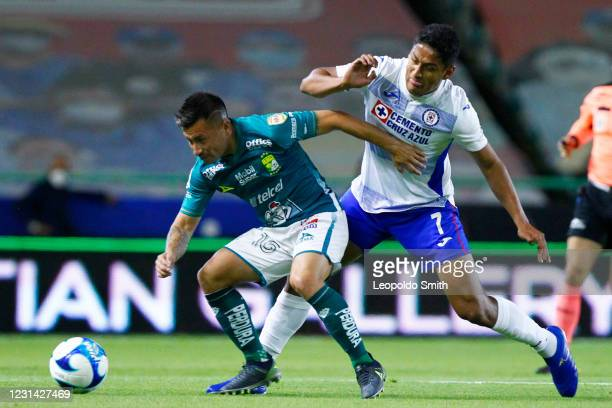 Jean Meneses of Leon competes for the ball with Luis Romo of Cruz Azul during the 8th round match between Leon and Cruz Azul as part of the Torneo...