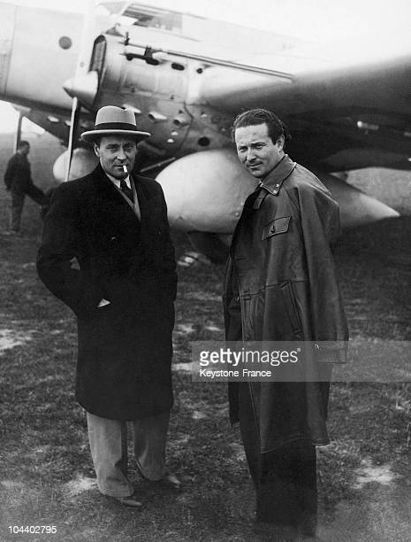 Jean MERMOZ and the plane manufacturer Rene COUZINET standing in front of the trimotor plane 'ARCENCIEL' on April 30 1934 The famous French pilot...