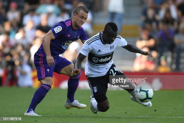 Jean Michael Seri is challenged by Stanislav Lobotka of Celta Vigo during a PreSeason Friendly between Fulham and Celta Vigo at Craven Cottage on...