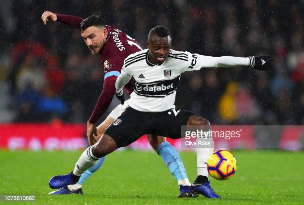 Jean Michael Seri of Fulham battles for possession with Robert Snodgrass of West Ham United during the Premier League match between Fulham FC and...