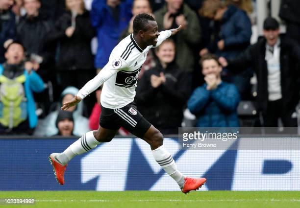 Jean Michael Seri of Fulham celebrates after scoring his team's first goal during the Premier League match between Fulham FC and Burnley FC at Craven...