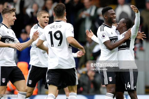 Jean Michael Seri of Fulham celebrates with teammates after scoring his team's first goal during the Premier League match between Fulham FC and...