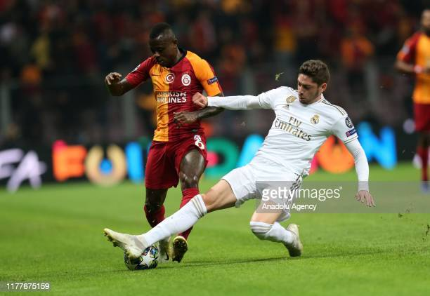 Jean Michael Seri of Galatasaray and Federico Valverde of Real Madrid vie for the ball during the UEFA Champions League Group A match between...