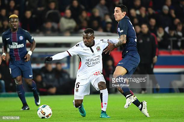 Jean Michael Seri of Nice and Angel Di Maria of PSG during the French Ligue 1 match between Paris Saint Germain and Nice at Parc des Princes on...
