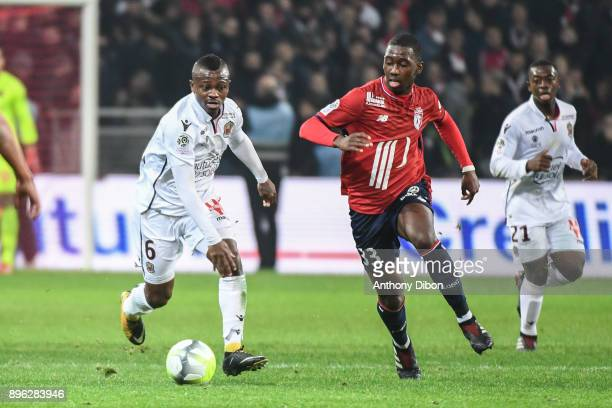 Jean Michael Seri of Nice and Boubakary Soumare of Lille during the Ligue 1 match between Lille OSC and OGC Nice at Stade Pierre Mauroy on December...