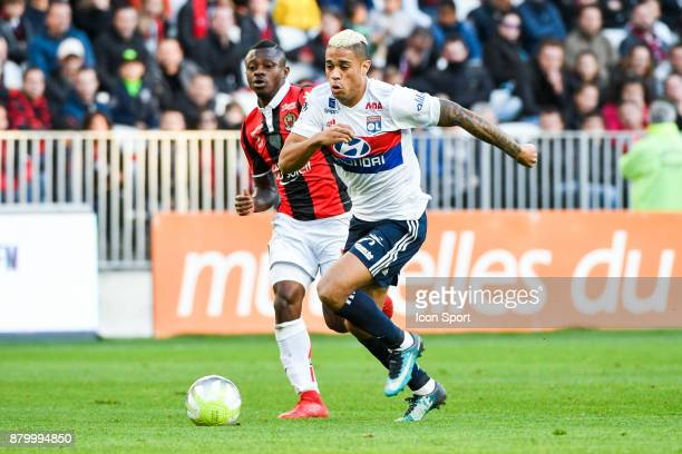 Jean Michael Seri of Nice and Mariano Diaz of Lyon during the Ligue 1 match between OGC Nice and Olympique Lyonnais at Allianz Riviera on November 26...