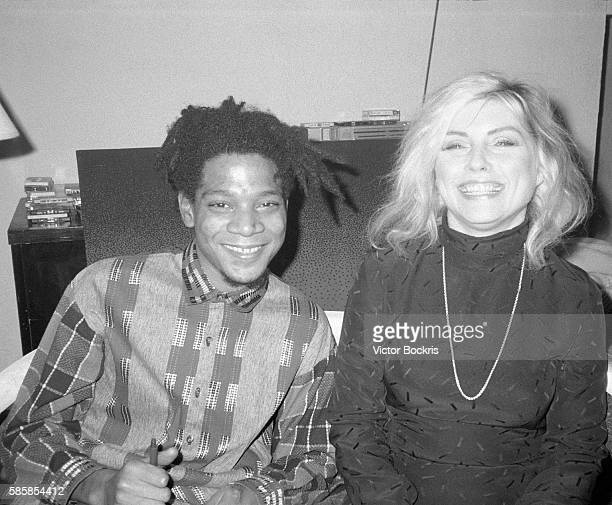 Jean Michel Basquait and Debbie Harry in New York City around Christmas of 1986
