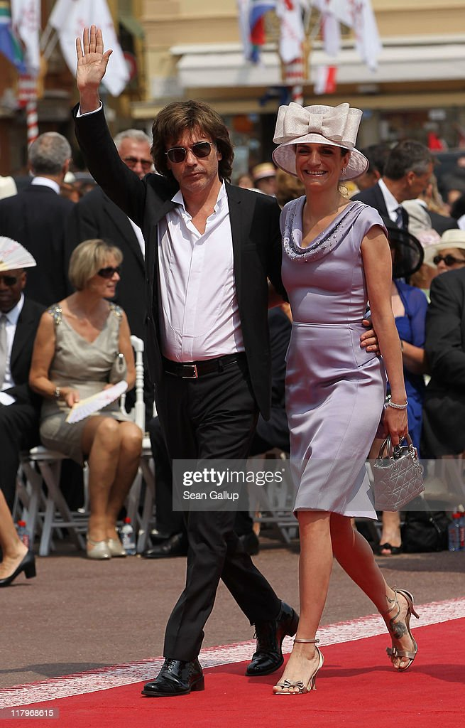 Jean Michel Jarre and guest attend the religious ceremony of the Royal Wedding of Prince Albert II of Monaco to Princess Charlene of Monaco in the main courtyard at the Prince's Palace on July 2, 2011 in Monaco. The Roman-Catholic ceremony follows the civil wedding which was held in the Throne Room of the Prince's Palace of Monaco on July 1. With her marriage to the head of state of the Principality of Monaco, Charlene Wittstock has become Princess consort of Monaco and gains the title, Princess Charlene of Monaco. Celebrations including concerts and firework displays are being held across several days, attended by a guest list of global celebrities and heads of state.