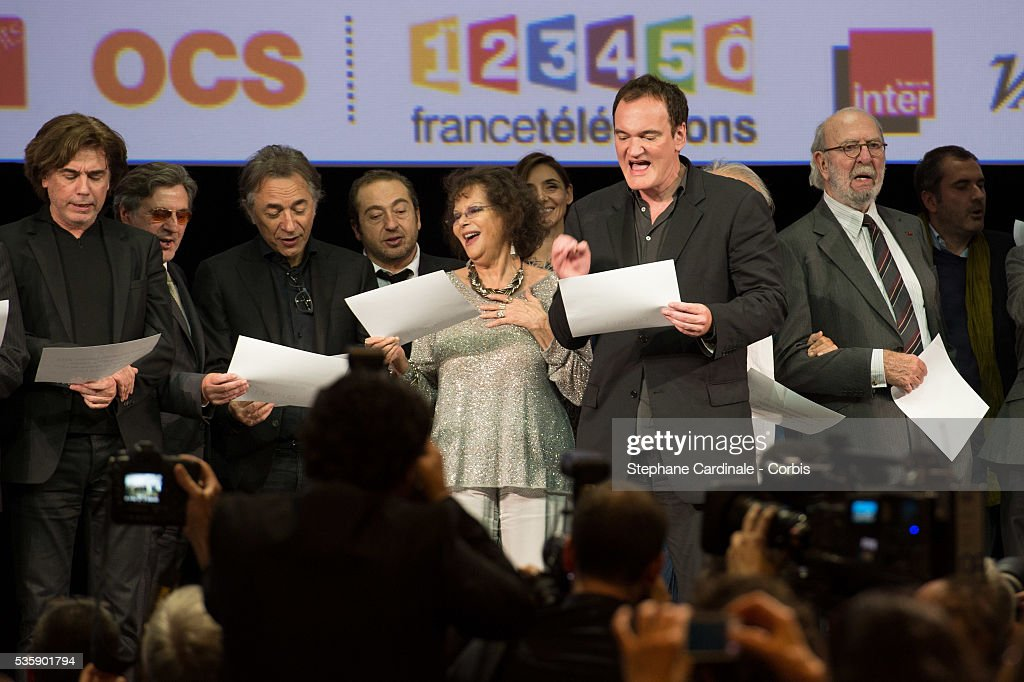 Jean Michel Jarre, Daniel Auteuil, Richard Berry, Patrick Timsit, Claudia Cardinale, Quentin Tarantino and Jean Pierre Marielle on stage during the Tribute to Jean Paul Belmondo and Opening Ceremony of the Fifth Lumiere Film Festival, in Lyon.
