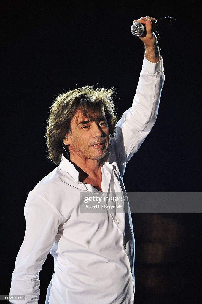 Jean Michel Jarre performs onstage during a concert celebrating the Royal Wedding of Prince Albert II of Monaco to Princess Charlene of Monaco at the Port of Monaco on July 1, 2011 in Monaco. The civil ceremony took place in the Throne Room of the Prince's Palace of Monaco, followed by a religious ceremony to be conducted in the main courtyard of the Palace on July 2. With her marriage to the head of state of Principality of Monaco, Charlene Wittstock has become Princess consort of Monaco and gains the title, Princess Charlene of Monaco. Celebrations including concerts and firework displays are being held across several days, attended by a guest list of global celebrities and heads of state.