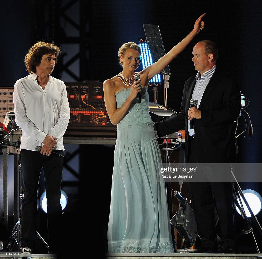 Jean Michel Jarre, Princess Charlene of Monaco and Prince Albert II of Monaco appear onstage during the Jean Michel Jarre concert celebrating the Royal Wedding of Prince Albert II of Monaco to Princess Charlene of Monaco at the Port of Monaco on July 1, 2011 in Monaco. The civil ceremony took place in the Throne Room of the Prince's Palace of Monaco, followed by a religious ceremony to be conducted in the main courtyard of the Palace on July 2. With her marriage to the head of state of Principality of Monaco, Charlene Wittstock has become Princess consort of Monaco and gains the title, Princess Charlene of Monaco. Celebrations including concerts and firework displays are being held across several days, attended by a guest list of global celebrities and heads of state.
