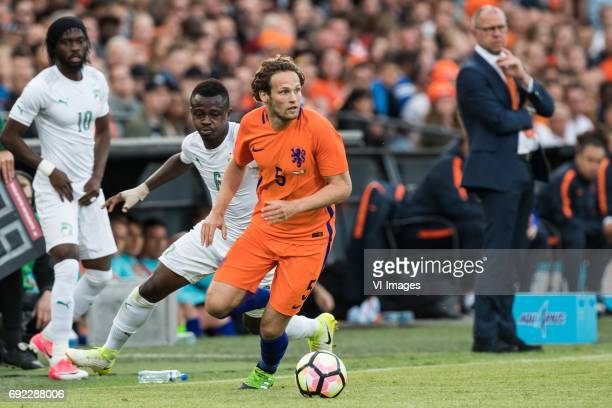 Jean Michel Seri of Ivory Coast Daley Blind of The Netherlandsduring the friendly match between The Netherlands and Ivory Coast at the Kuip on June 4...