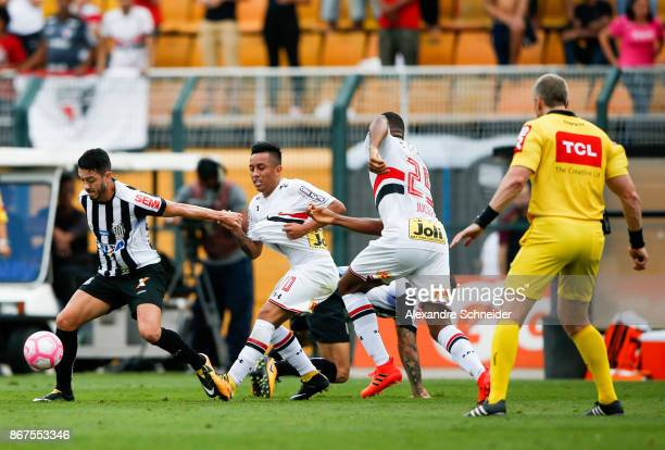 Jean Mota of Santos and Cueva of Sao Paulo in action during the match between Sao Paulo and Santos for the Brasileirao Series A 2017 at Pacaembu...