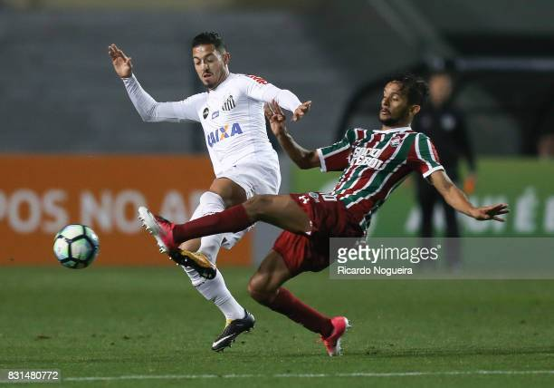 Jean Mota of Santos battles for the ball with Gustavo Scarpa of Fluminense during the match between Santos and Fluminense as a part of Campeonato...