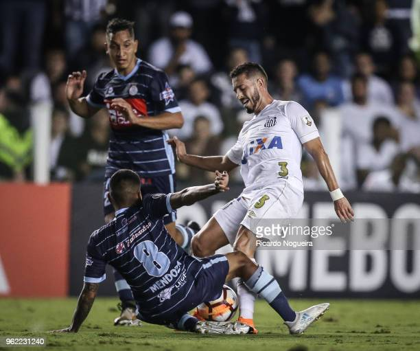 Jean Mota of Santos battles for the ball with Mendoza of Real Garcilaso during the match between Santos and Real Garcilaso as a part of Copa...