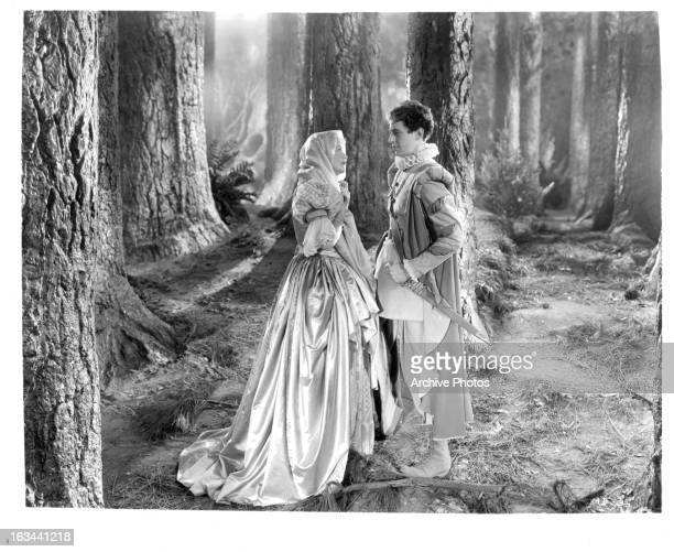 Jean Muir and Ross Alexander in forest looking into each other's eyes in a scene from the film 'A Midsummer Night's Dream' 1935