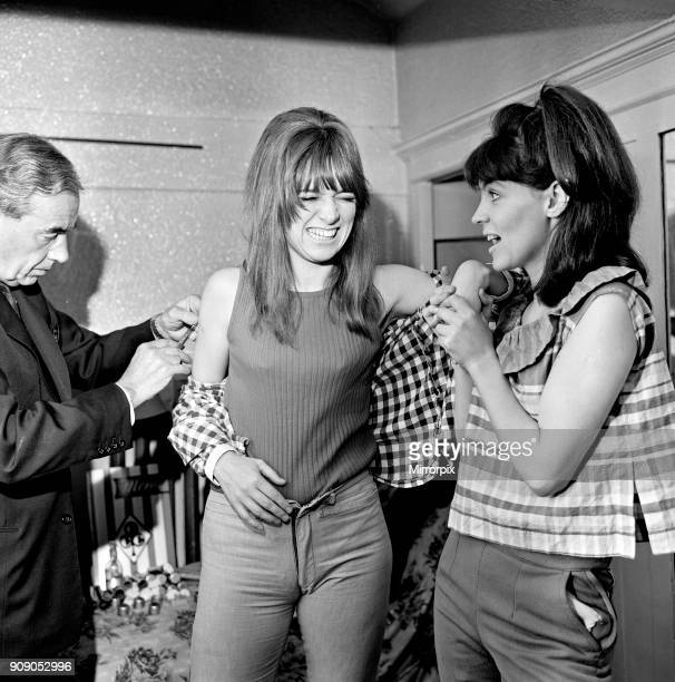Jean Muir left and Pauline Collins two of the cast members of 'Passion Flower Hotel' receiving injections of vitamin B12 The pair line up for a big...