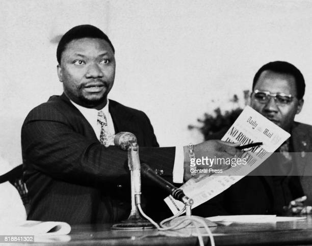 Jean Nguza KarliBond the Foreign Minister of Zaire refers to the headline of the 'Daily Mail' during a press conference at the Zairian embassy in...