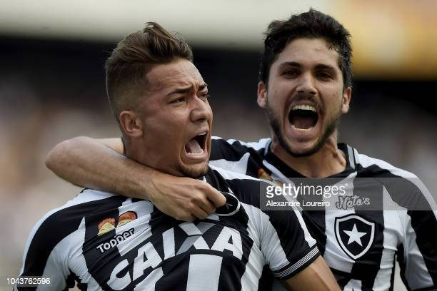 Jean of Botafogo celebrates their first scored goal with Igor Rabello during the match between Botafogo and Sao Paulo as part of Brasileirao Series A...