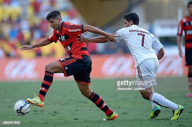Jean of Fluminense battles for the ball with Lucas Mugni of Flamengo during the match between Fluminense and FlamengoÊ as part of Brasileirao Series...