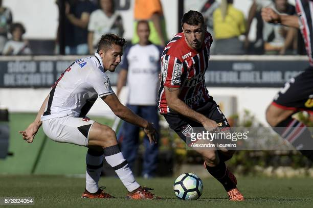 Jean of Vasco da Gama struggles for the ball with Lucas Pratto of Sao Paulo during the match between Vasco da Gama and Sao Paulo as part of...