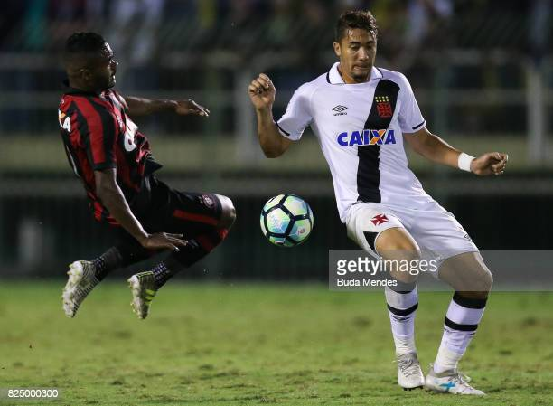 Jean of Vasco da Gama struggles for the ball with Nikao of Atletico PR during a match between Vasco da Gama and Atletico PR as part of Brasileirao...