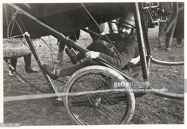 Jean Ors sits in a monoplane designed by Deperdussin he is about to test a parachute he invented for aviators