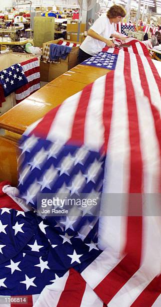 Jean Oumpenhauer cuts American flags into sections October 2 2001 at the Valley Forge Flag Company in Womelsdorf Pennsylvania Company officials said...