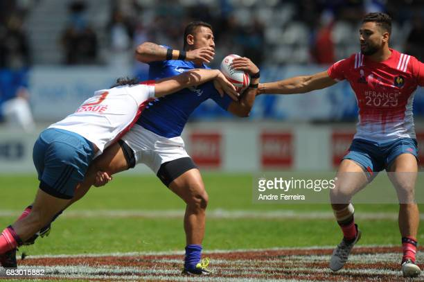 Jean Pascal Barraque of France and Alatasi Tupou of Samoa and Sacha Valleau of France during the quarter final match between Samoa and France at the...
